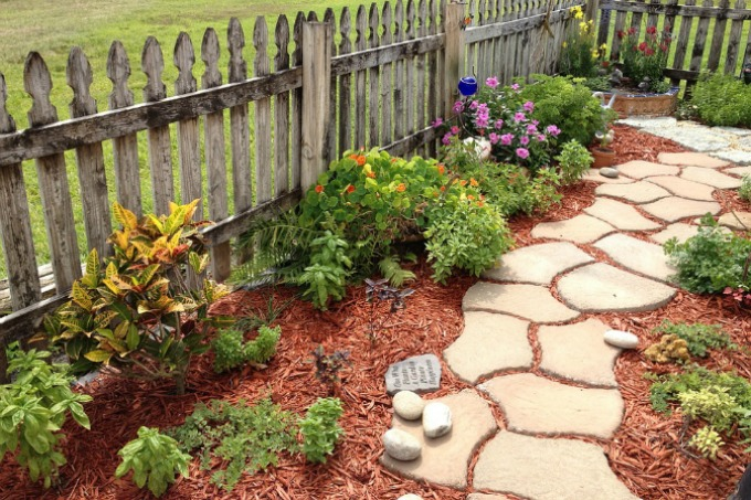 Light colored mulch for a flower bed